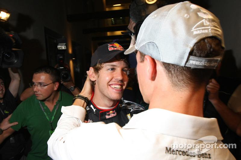 Michael Schumacher, Mercedes GP congratulates Sebastian Vettel, Red Bull Racing