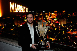 Five-time NASCAR Sprint Cup Series Champion Jimmie Johnson poses with the 2010 trophy at the House of Blues Foundation Room inside Mandalay Bay Resort & Casino