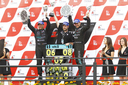 Podium: 2010 FIA GT1 World Champions Andrea Bertolini en Michael Bartels