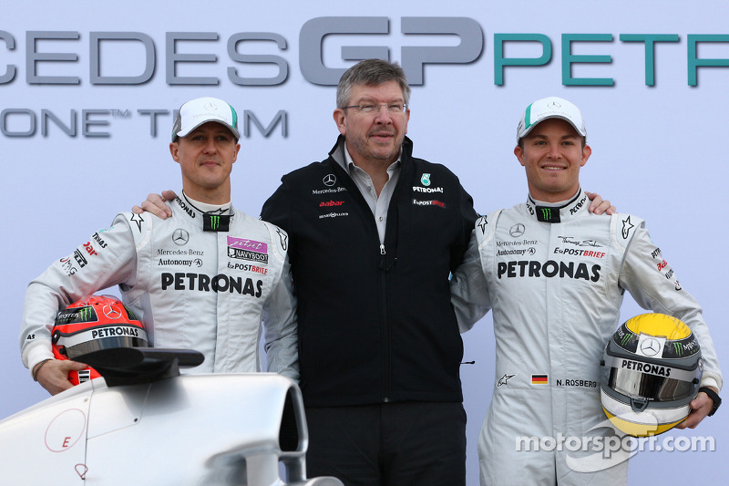 Michael Schumacher, Mercedes GP F1 Teamwith Ross Brawn Team Principal, Mercedes GP and Nico Rosberg, Mercedes GP F1 Team