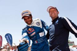 Car category winner Nasser Al Attiyah celebrates with Kris Nissen
