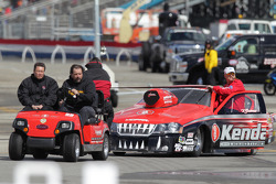 Vieri Gaines aboard his Kendall Dodge Stratus being towed to the weight  scales