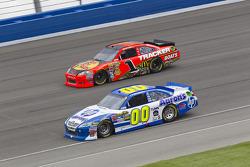 David Reutimann, Michael Waltrip Racing Toyota and Jamie McMurray, Earnhardt Ganassi Racing Chevrolet