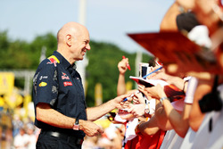 Adrian Newey, Red Bull Racing Chief Technical Officer signs autographs for fans