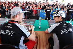 (L to R): Nico Hulkenberg, Sahara Force India F1 and Sergio Perez, Sahara Force India F1 with fans