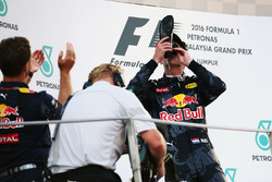 Second placed Max Verstappen, Red Bull Racing celebrates on the podium by drinking champagne from the race boot of race winner Daniel Ricciardo, Red Bull Racing