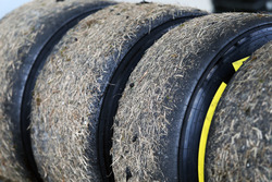 Worn Pirelli tyres covered in grass