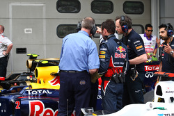 FIA talking with the mechanicsfrom Red Bull overr the car of Sebastian Vettel, Red Bull Racing