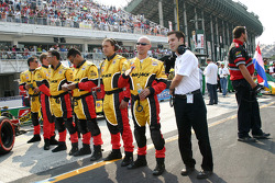 Conquest Racing crew members on the starting grid