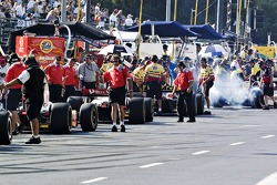 Pit lane action during practice