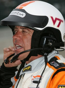 A Champ Car official wears a 'Virginia Tech' logo on his helmet
