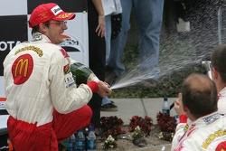 Podium: race winner Sébastien Bourdais celebrates
