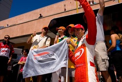 Justin Wilson celebrates winning the pole