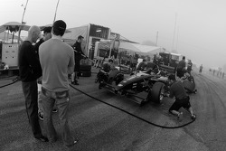 Pacific Coast Motorsports team members practice pit stops as Alex Figge looks on