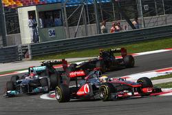 Lewis Hamilton, McLaren Mercedes leads Michael Schumacher, Mercedes GP F1 Team