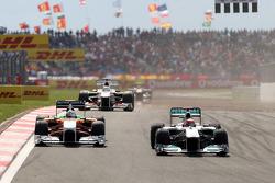 Michael Schumacher, Mercedes GP F1 Team, MGP W02 leads Adrian Sutil, Force India F1 Team, VJM-04