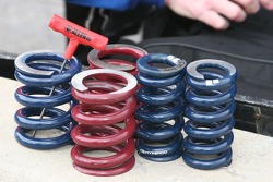 Indy Car springs sit ready on the pit wall