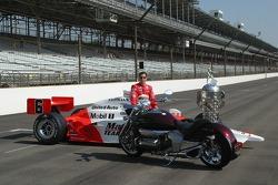 Sam Hornish Jr. admires his new Honda motorcycle