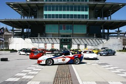 The 2006 Chevrolet Corvette Z06 leads a group of all 17 Chevrolet vehicles that have paced the Indianapolis 500 in front of the Bombardier Pagoda