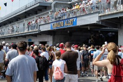 Fans crowd over Gasoline Alley, looking for cars and drivers