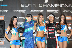 Darren McNamara and Daijiro Yoshihara celebrate with the Falken girls