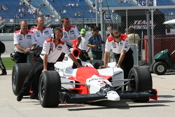 Team Penske team members push the #3 car