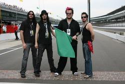 Band SALIVA pose on yard of brick prior to start of Fast Friday