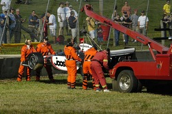 Tomas Scheckter car being lifted