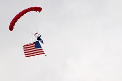 Skydiver brings the American flag