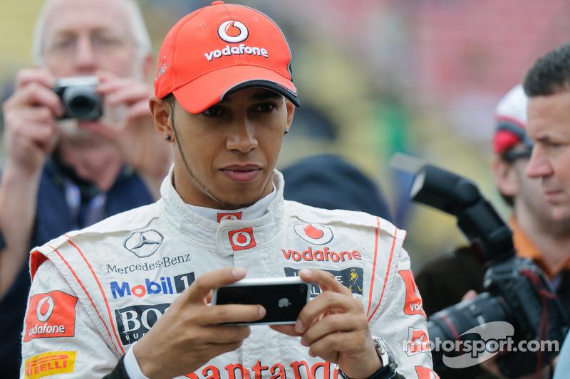 Lewis Hamilton takes a photo of his new ride