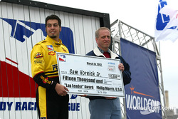 Sam Hornish Jr. accepting the Lap Leader Award check before the race