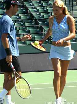 Helio Castroneves and WTA tennis star Anna Kournikova at an exhibition tennis match at the Tennis Center at Crandon Park in Key Biscayne