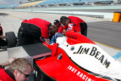 Andretti Green Racing crew members prepare the two seater car