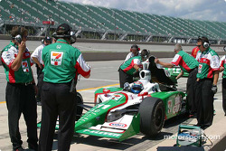 Tony Kanaan waits as his crew prepares the car