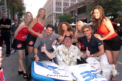 Patrick Carpentier and Alex Tagliani pose with the Molson Indy Girls and the winner of the 'Gentlemen Start you engines' contest