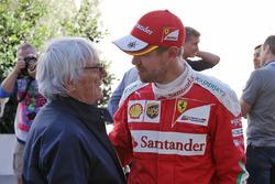 (L to R): Bernie Ecclestone, with Sebastian Vettel, Ferrari