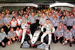The McLaren team celebrate winning the Constructors Championship with the new World Champion Mika Hakkinen