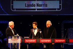 Lando Norris is presented with the British Club Driver of the Year trophy by Vijay Mallya