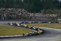 Nigel Mansell, Williams FW11B Honda; Teo Fabi, Benetton B187 Ford; Ayrton Senna, Lotus 99T Honda