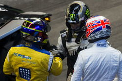 Juan Pablo Montoya, talks with Petter Solberg and Jenson Button,