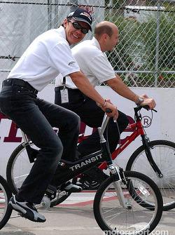 Adrian Fernandez rides his bike around the track