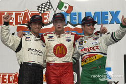 Podium: race winner Sébastien Bourdais with Bruno Junqueira and Mario Dominguez