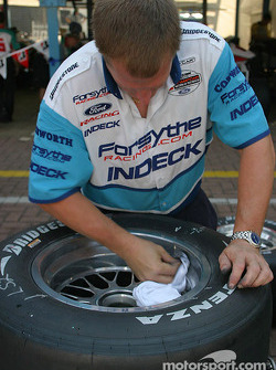 Forsythe Championship Racing crew member prepares tires