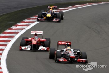 The top-three captured in one image, Hamilton, Alonso and Webber