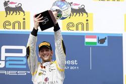 Romain Grosjean celebrates his fifth feature race win of the season on the podium