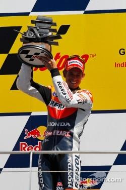 Podium: race winner Casey Stoner, Repsol Honda Team, celebrates his seventh victory of the 2011 season