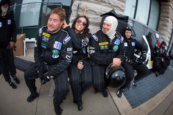 Dyson Racing team members relax before a round of pit stops