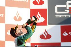Valtteri Bottas celebrates victory and winning the drivers championship on the podium
