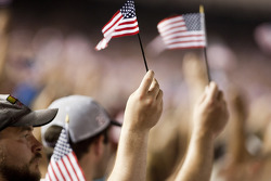 Fans go silent and wave American flags in remembrance of September 11 2001 on laps 9 through 11