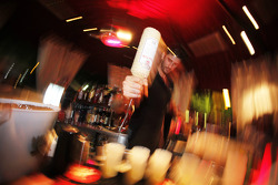 A bar man serves drinks